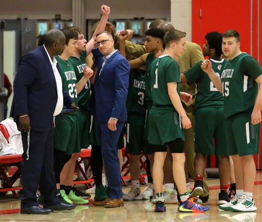 Head coach Chris Bubble and his players huddle during Newfield's 63-60 win over Watkins Glen in the Section 4 Class C boys basketball championship game March 7, 2020 at SUNY Cortland.