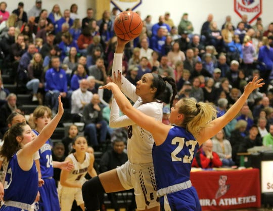 Zaria DeMember-Shazer of Elmira takes a shot as Horseheads' Jenna Granger (23) defends during the Express' 70-50 win in the Section 4 Class AA girls basketball championship game March 6, 2020 at Elmira High School.