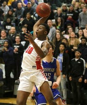 Colbie Young of Binghamton gains control of the ball during an 84-82 overtime win over Horseheads in the Section 4 Class AA boys basketball championship game March 6, 2020 at Elmira High School.