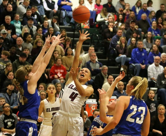 Kiara Fisher of Elmira takes a shot as Horseheads' Jillian Casey (left defends during the Express' 70-50 win in the Section 4 Class AA girls basketball championship game March 6, 2020 at Elmira High School.