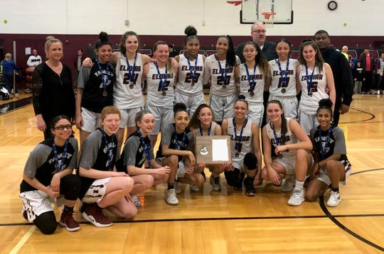 Elmira poses with its championship plaque after a 70-50 win over Horseheads in the Section 4 Class AA girls basketball final March 6, 2020 at Elmira High School.