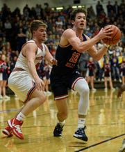 Heritage Hills' Simon Scherry (12) has been named Courier & Press 2020 All-Southwestern Indiana boys' basketball player of the year.