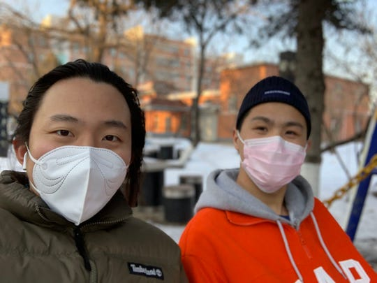 Jo Ma, pictured at left in this furnished photo, is a former Evansville exchange student living in China. He says people there don't think Americans take coronavirus seriously.