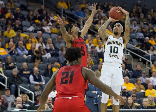 Murray State's Tevin Brown (10) takes three-point shot as the Murray State Racers play the Austin Peay Governors during their semifinal game of the Ohio Valley Conference championships at Ford Center Friday evening, March 6, 2020.