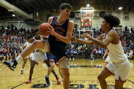 Heritage Hills' Blake Sisley (52) rebounds the ball during the Class 3A sectional semifinal against the Bosse Bulldogs at Boonville High School in Boonville, Ind., Friday, March 6, 2020. The Bulldogs ended their season with a 54-47 loss to the Patriots.