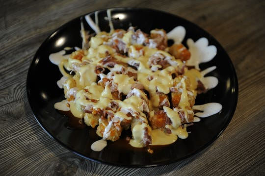 """Tots loaded with queso, ranch, hot sauce and """"pulled bacon"""" at the Half Moon Saloon in Mount Vernon."""