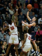 Murray Becher shoots over Bosse's Kiyron Powell in Heritage Hills' 54-47 victory in the Class 3A Boonville Sectional semifinals.