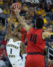 Austin Peay's Eli Abaev (14) blocks DaQuan Smith (1) as the Austin Peay Governors play the Murray State Racers during their semifinal game of the Ohio Valley Conference championships at Ford Center Friday evening, March 6, 2020.