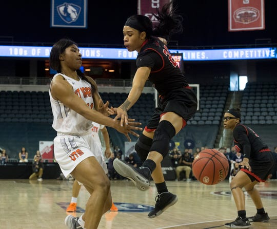 UT Martin's Dasia Young (11) passes the ball against Southeast Missouri's Tesia Thompson (24) during their Ohio Valley Conference Championship game at Ford Center Saturday afternoon, March 7, 2020.