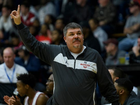 Bosse Coach Shane Burkhart reacts to his team netting two more points during the Class 3A sectional semifinal against the Heritage Hills Patriots at Boonville High School in Boonville, Ind., Friday, March 6, 2020. The Bulldogs ended their season with a 54-47 loss to the Patriots.