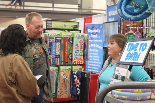 Darla Jones, right, of Swim Rite Pools in Fremont, speaks with a couple attendees at the SCBA's 43rd annual Home and Business Show.