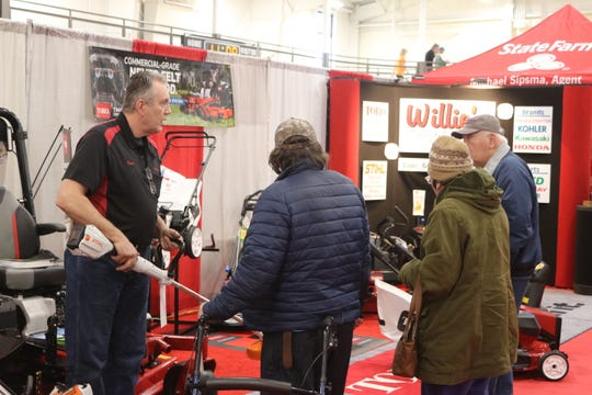 Chuck Schepflin, left, of Willie's Sales and Service in Fremont, speaks with a few attendees at the SCBA's 43rd annual Home and Business Show.
