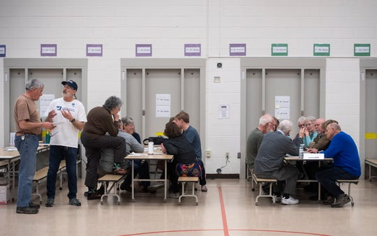 Members participate in the Democratic caucus at Lopez Elementary in Fort Collins, Colo. on Saturday, March 7, 2020.
