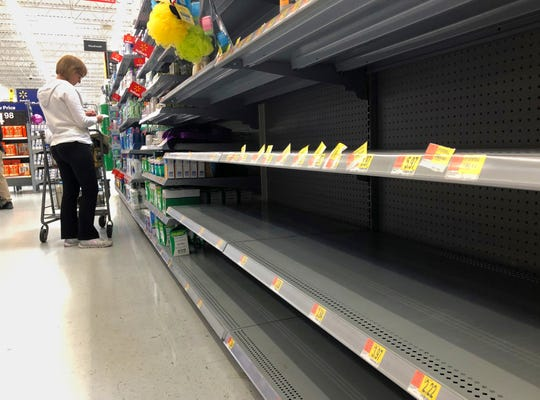 Rows of store shelves sold out of hand sanitizers and antibacterial soaps at a Walmart in Port St. Lucie Florida, Saturday, March 7, 2020. Panic buying across the United States in fear of the coronavirus has depleted stores of face masks, antibacterial cleansers, toilet paper and other supplies.