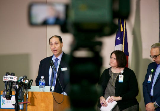 Lee Health Preside and CEO Larry Antonucci, left, speaks at a press conference about COVID-19 cases and preparedness at Gulf Coast Hospital on Saturday, March 7, 2020.