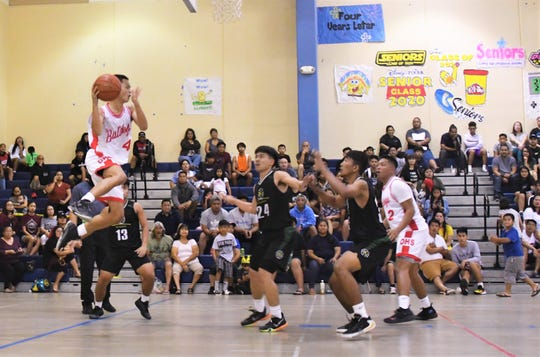Scenes from the ISA boys basketball championship game held March 7 at Okkodo High School. The John F. Kennedy Islanders, which finished in second place after the regular season, stunned the Bulldogs 80-68 led by Rodson SImina's 28 points.