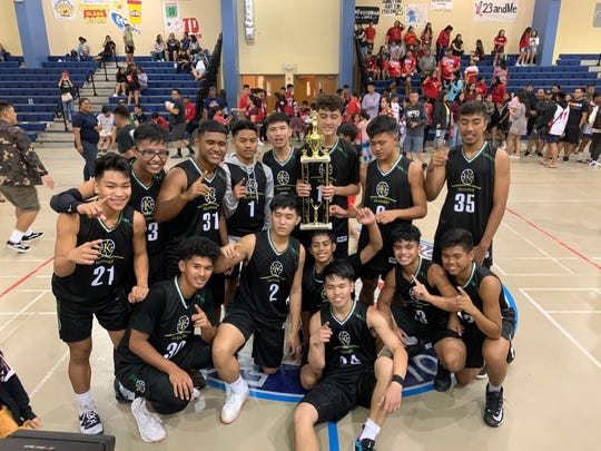The JFK Islanders with the first ever Interscholastic Sports Association championship trophy following their 80-68 win over the Okkodo Bulldogs March 7 at Okkodo High.