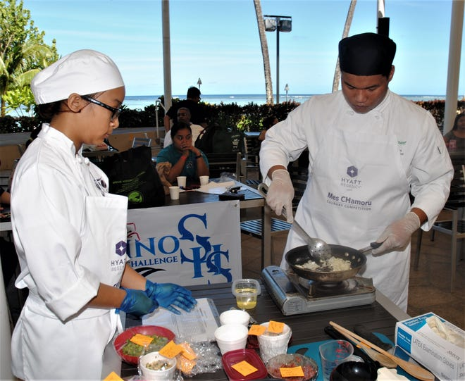 Lakisha Duenas and Mark Banes of Southern High compete in the Mes CHamoru Culinary Competition March 7 at the Hyatt Regency Guam.