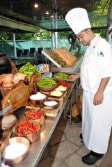 Brendan Makahi, Hyatt Regency Guam chef de cuisine looks over dinanche ingredients at the Mes CHamoru Culinary Competition March 7 at the Hyatt Regency Guam.