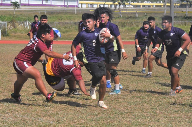 The George Washington High Geckos' Mykai Blas looks for an opening late in a semifinal rugby game against the Father Duenas Memorial School Friars on March 7 at the GW field in Mangilao. FD advanced to the championship game next week with a 58-0 victory