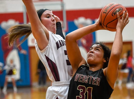 Webster County's Raigan Price (31) shoots over Madisonville's Lindsey Peyton (32) as the Webster County Lady Trojans play the Madisonville Lady Maroons in the Second Region semifinals at Christian County High School Friday, March 6, 2020.