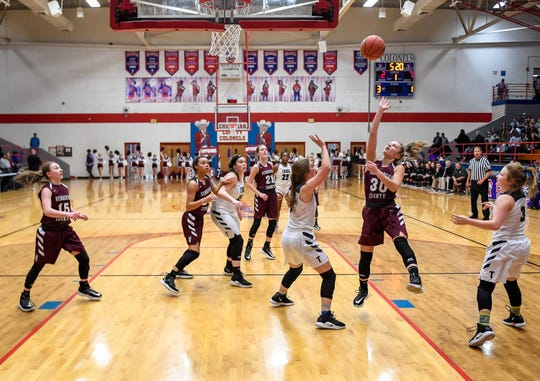 Henderson County's Emilee Hope (30) shoots from the paint as the Henderson County Lady Colonels play the Trigg County Lady Wildcats in the Second Region semifinals at Christian County High School Friday, March 6, 2020.