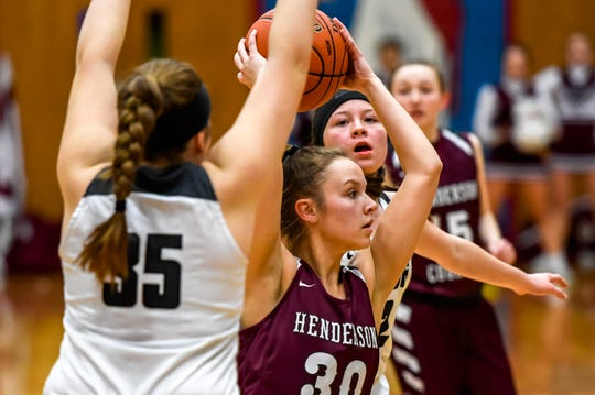 Henderson County's Emilee Hope (30) looks to pass as the Henderson County Lady Colonels play the Trigg County Lady Wildcats in the Second Region semifinals at Christian County High School Friday, March 6, 2020.