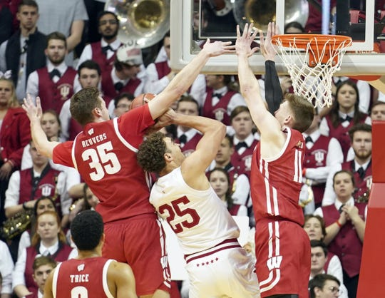 Indiana Hoosiers forward Race Thompson (25) is fouled by Wisconsin Badgers forward Nate Reuvers (35) during the game against Wisconsin at Simon Skjodt Assembly Hall in Bloomington, Ind., on Saturday, March 7, 2020.