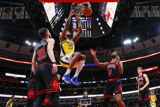 Mar 6, 2020; Chicago, Illinois, USA; Indiana Pacers center Myles Turner (33) scores against the Chicago Bulls during the first half at United Center. Mandatory Credit: Kamil Krzaczynski-USA TODAY Sports