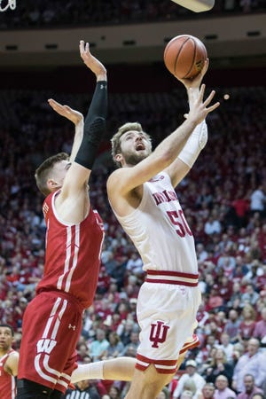 Mar 7, 2020; Bloomington, Indiana, USA; Indiana Hoosiers forward Joey Brunk (50) shoots the ball while Wisconsin Badgers forward Micah Potter (11) defends in the first half at Simon Skjodt Assembly Hall.