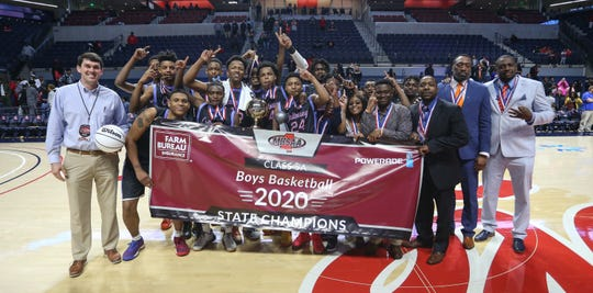 The Callaway boys basketball team poses for a picture after winning the MHSAA Class 5A basketball championship on Friday, March 6, 2020, at The Pavilion at Ole Miss.