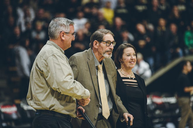 Purdue radio broadcaster Larry Clisby (center) stands at halfcourt during the Purdue vs. Rutgers men's basketball game on Saturday, March 7, 2020, in West Lafayette, Indiana. Clisby received the Sagamore of the Wabash award.