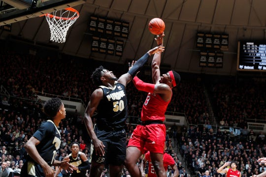 Mar 7, 2020; West Lafayette, Indiana, USA;  Rutgers Scarlet Knights forward Shaq Carter (13) takes a shot against Purdue Boilermakers forward Trevion Williams (50) during the first half at Mackey Arena. Mandatory Credit: Brian Spurlock-USA TODAY Sports
