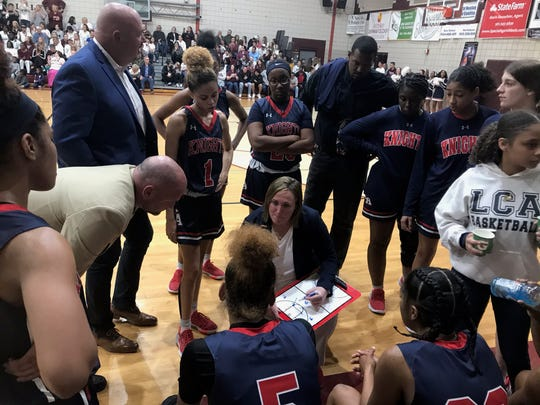 Lafayette Christian's head basketball coach Lexie Taylor discusses a strategy with her team during a timeout of their Division III state championship game against St. Thomas Aquinas in Hammond on Friday.