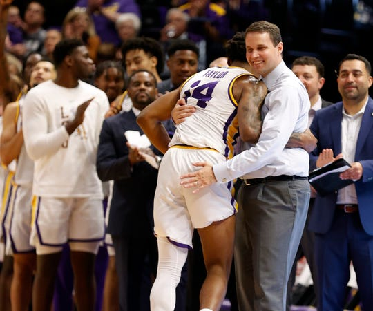 Mar 7, 2020; Baton Rouge, Louisiana, USA; LSU Tigers guard Marlon Taylor (14) hugs LSU Tigers head coach Will Wade as he comes out the game against Georgia Bulldogs in his final home game as a LSU Tigers during the second half at Maravich Assembly Center. Mandatory Credit: Stephen Lew-USA TODAY Sports