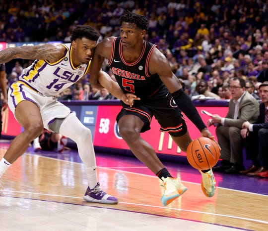 Mar 7, 2020; Baton Rouge, Louisiana, USA; Georgia Bulldogs guard Anthony Edwards (5) dribblers against LSU Tigers guard Marlon Taylor (14)  during the second half at Maravich Assembly Center. Mandatory Credit: Stephen Lew-USA TODAY Sports