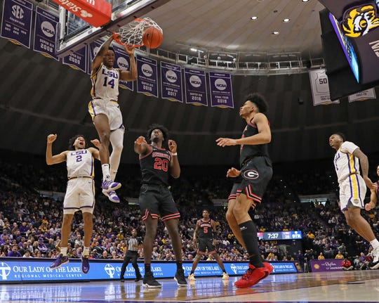Mar 7, 2020; Baton Rouge, Louisiana, USA;  LSU Tigers guard Marlon Taylor (14) dunks the ball against Georgia Bulldogs forward Rayshaun Hammonds (20) during the first half at Maravich Assembly Center. Mandatory Credit: Stephen Lew-USA TODAY Sports