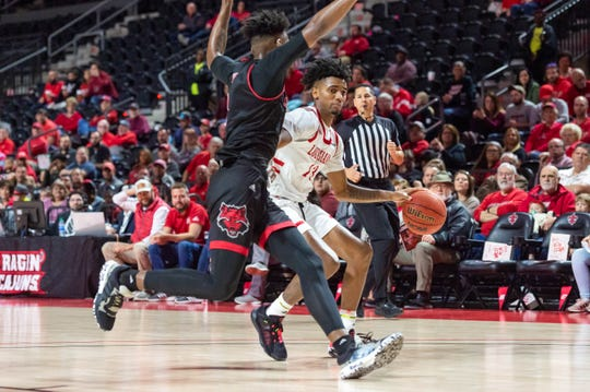 Mylik Wilson (13) scored a team-high 17 points in UL's Sun Belt Conference Tournament win over Arkansas State on Saturday at the Cajundome.