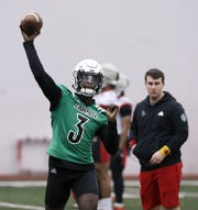 U of L QB Micale Cunningham (3) throws a pass during practice at the Trager Center in Louisville, Ky. on Mar. 6, 2020.