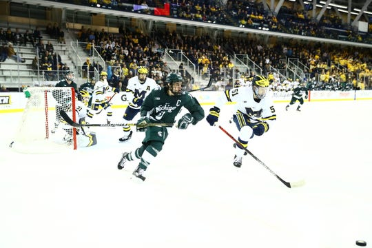 Michigan State forward Sam Saliba (left) skates after the puck with Michigan forward Garrett Van Wyhe (right) in the first period of MSU's game against Michigan on March 6, 2020. The Wolverines defeated the Spartans 3-0 in the first game of a best-of-three series