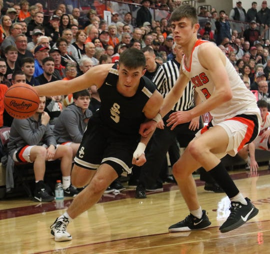 South Central's Isaiah Seidel drives to the basket during a 46-43 overtime district final loss to Lucas on Friday night in his final game of his high school career.