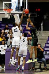 Lausanne's Moussa Cisse (23) blocks a shot by FACS' Daniel Egbuniwe (25) on Saturday during the Division II-A state championship game at Lipscomb University's Allen Arena in Nashville.