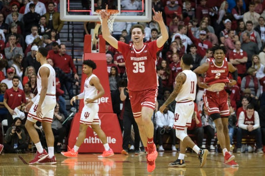 Nate Reuvers (35) and Aleem Ford begin to celebrate after Wisconsin knocked off Indiana to clinch at least a share of the Big Ten crown.
