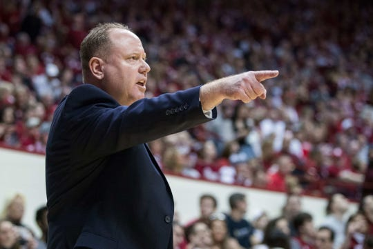 Badgers head coach Greg Gard directs his team during the first half against Indiana.