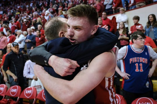 Wisconsin forward Micah Potter hugs head coach Greg Gard after the Badgers beat Indiana to clinch at least a share of the Big Ten regular-season title.