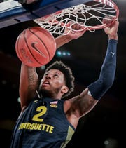 Marquette guard Sacar Anim throws down a dunk against St. John's.