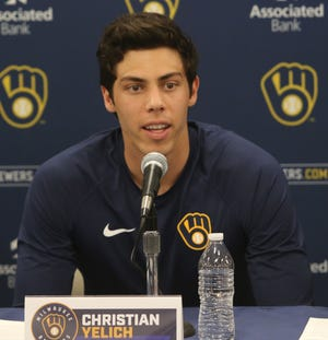 Brewers outfielder Christian Yelich answers questions after the announcement of his $188.5 million extension with the team.