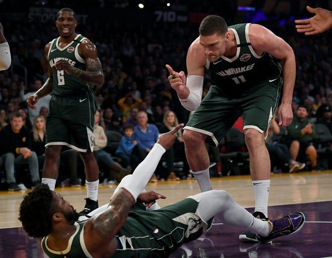 Brook Lopez and Wesley Matthews react after Matthews draws an offensive foul on LeBron James.