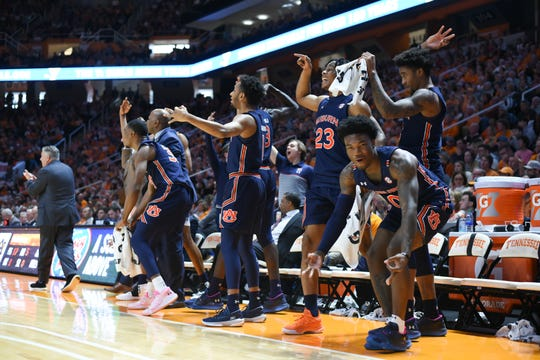 Auburn guard Tyrell Jones (0) and the rest of the bench react to a play against Tennessee on March 7, 2020.