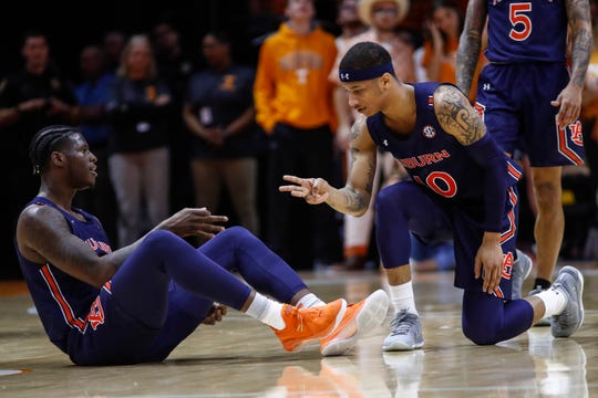 Auburn guard Samir Doughty (10) and forward Danjel Purifoy (3) react to a 3-point shot during an NCAA college basketball game against Tennessee, Saturday, March 7, 2020, in Knoxville, Tenn.